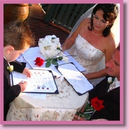child signing family wedding certificate