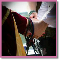 handfasting ceremony with coloured cords
