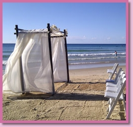 beach with wedding decorations for ceremony