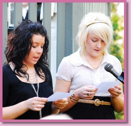 two wedding guests doing a reading at a wedding ceremony