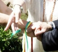 handfasting with hands joined in sign of infinity