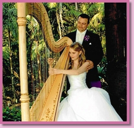 bride and groom playing harp after their ceremony